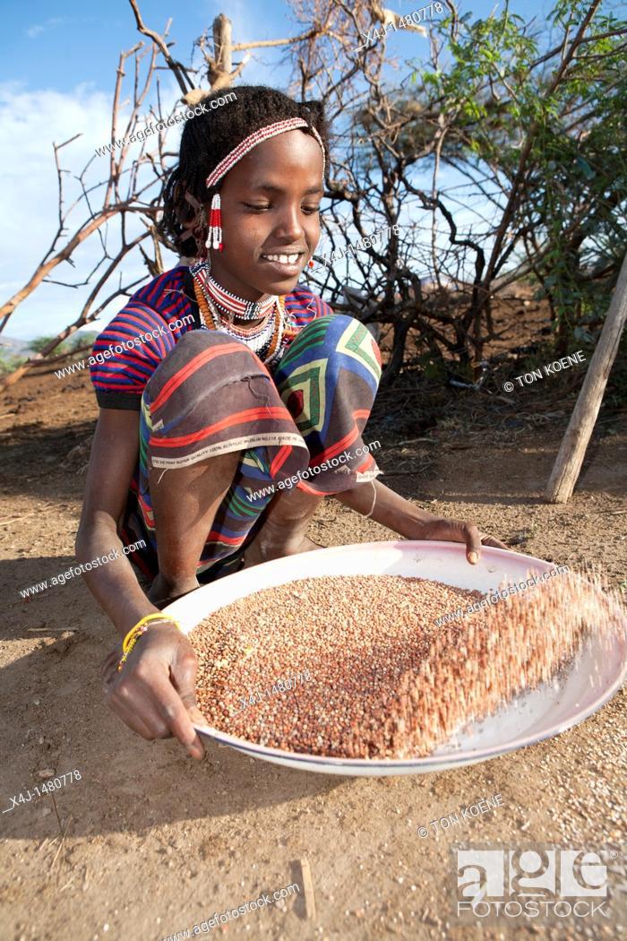 Stock Photo: Ethiopian girl at work.