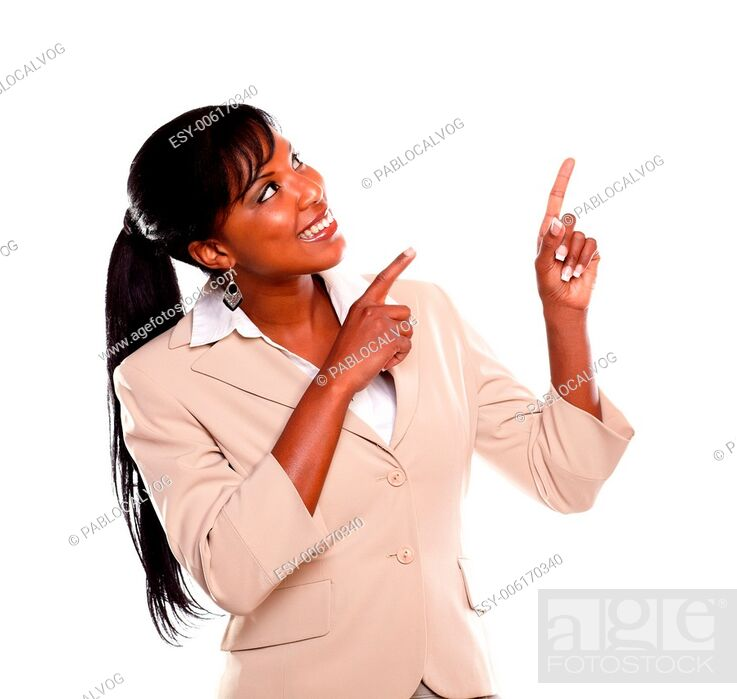 Stock Photo: Adult businesswoman looking and pointing up on isolated background.
