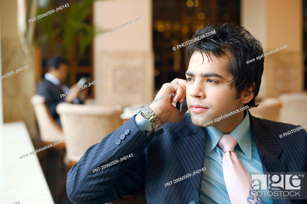 Stock Photo: Close-up of a businessman talking on a mobile phone.