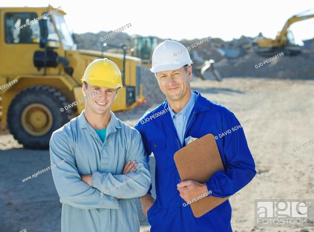 Stock Photo: Construction workers standing on construction site.