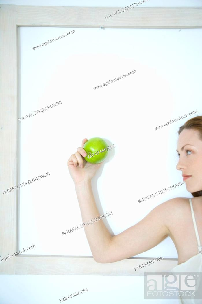 Stock Photo: young woman with apple.