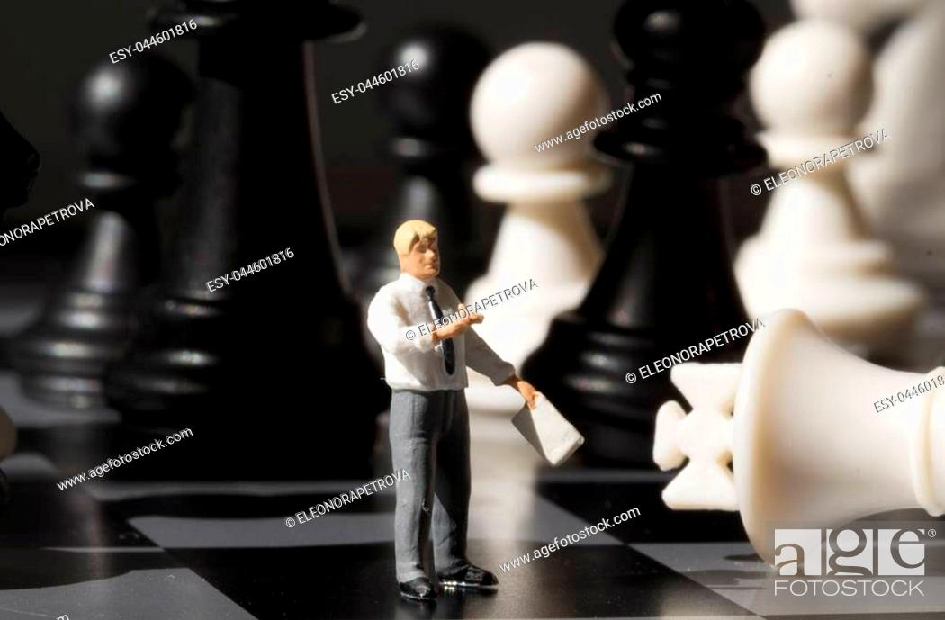 Chessman and chess king on game board  Playing chess with