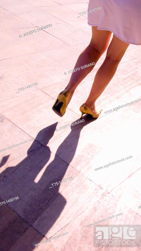Stock Photo: Woman with golden shoes,.