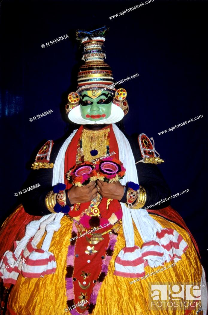 man performing indian classical Kathakali dance , kerala