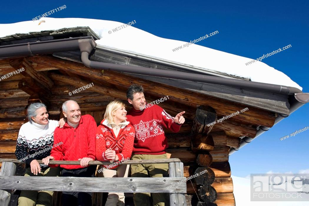 Stock Photo: Italy, South Tyrol, Seiseralm, Log Cabin, Couple standing on balcony.