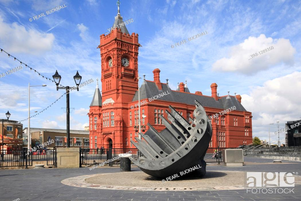 Stock Photo: Cardiff Bay Bae Caerdydd, Glamorgan, South Wales, UK, Europe  Merchant seamen's war memorial and Pierhead building on the waterfront.