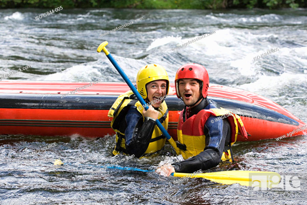 Stock Photo: Two people white water rafting.