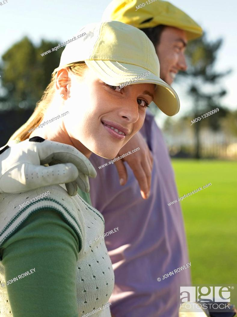 Stock Photo: Two young golfers on court focus on woman.