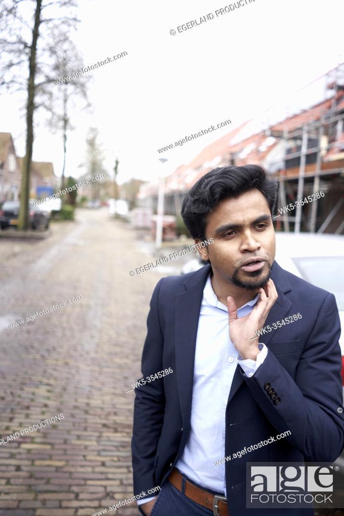 Stock Photo: Indian businessman thinking in Leeuwarden, Friesland, Netherlands, Europe.