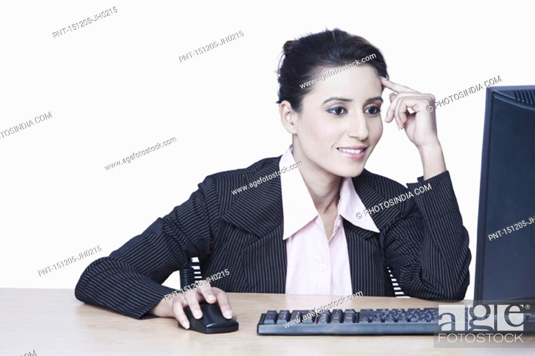 Stock Photo: Close-up of a businesswoman working on a computer.