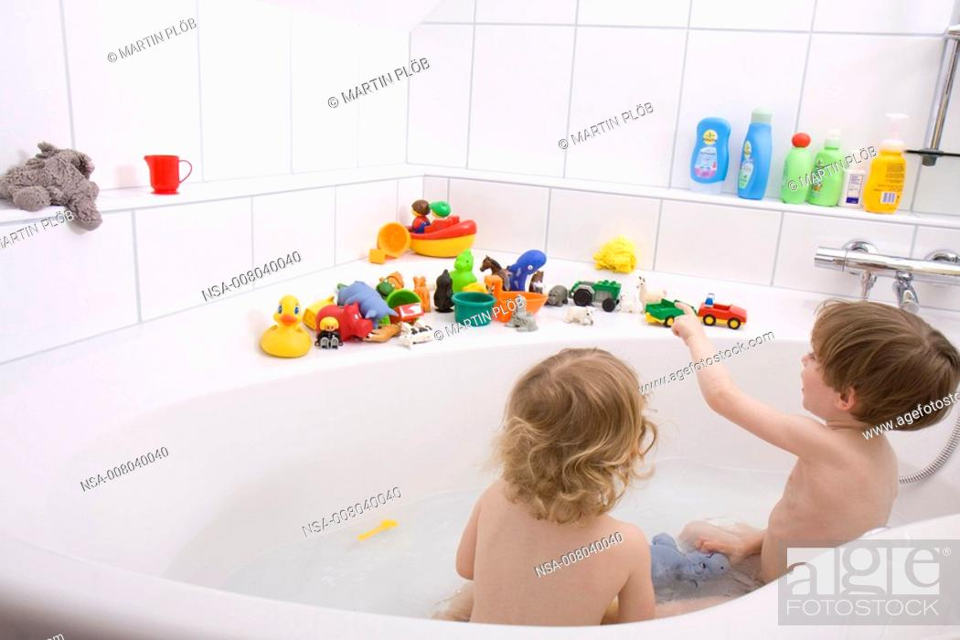 little children playing in the bath tub, Stock Photo, Picture And ...