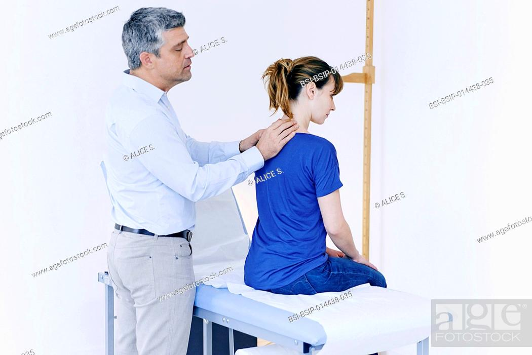 Stock Photo: Doctor examining patient's neck.