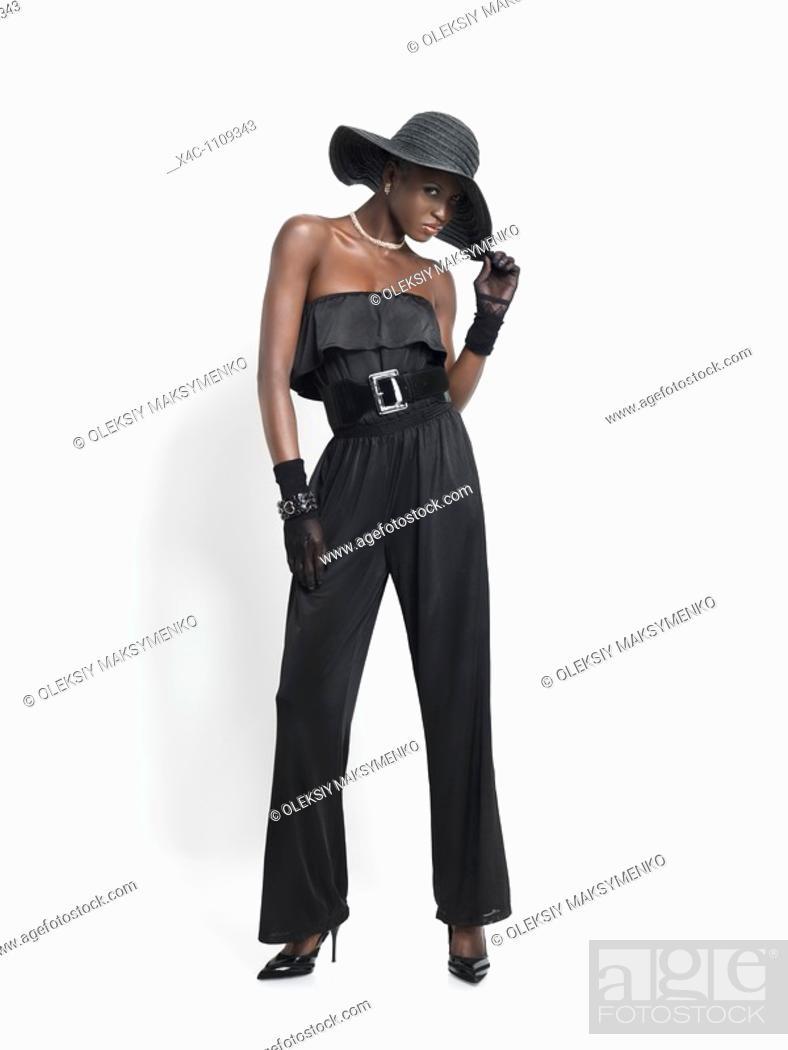 Stock Photo: Elegant young fashion model wearing black isolated on white background.
