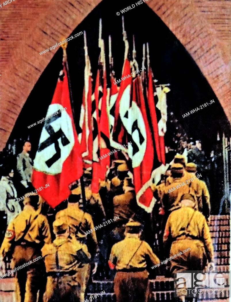 Stock Photo: Nazi swastika flags are carried into a German Church circa 1933-36.