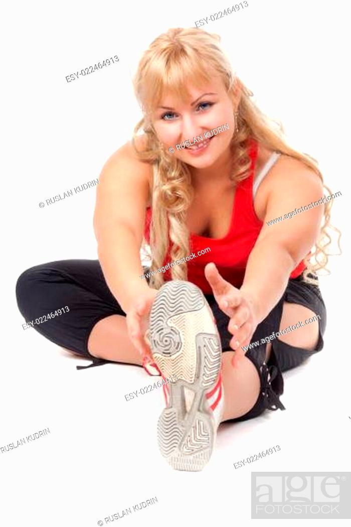 Stock Photo: The girl is engaged in fitness, do some exercises, leaning forwa.