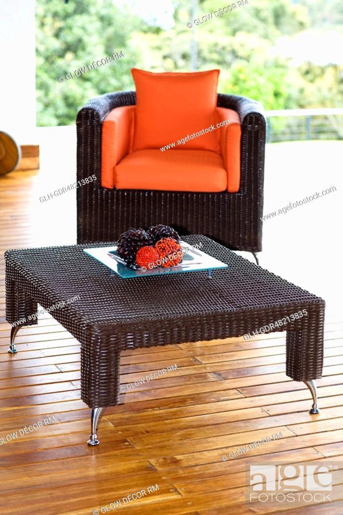 Photo de stock: Table and an armchair on the patio.
