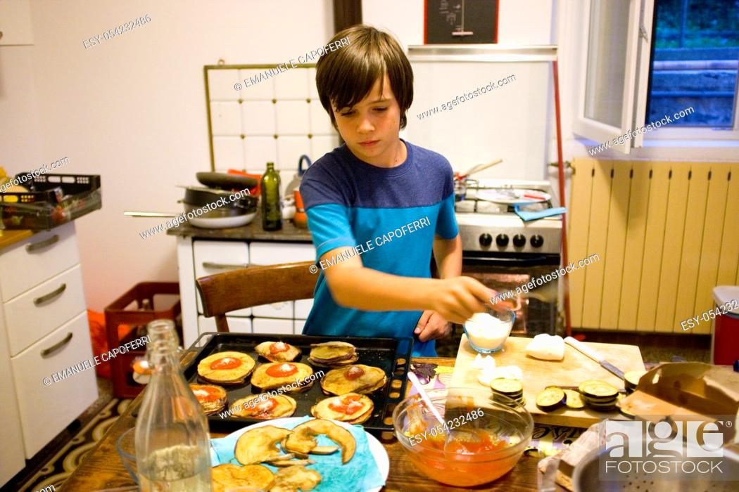 Stock Photo: 12 year old boy cooking.
