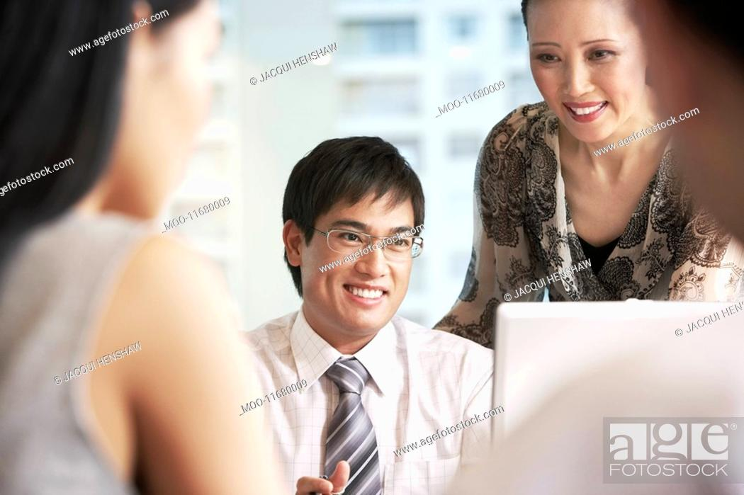 Stock Photo: Business people at meeting in office.