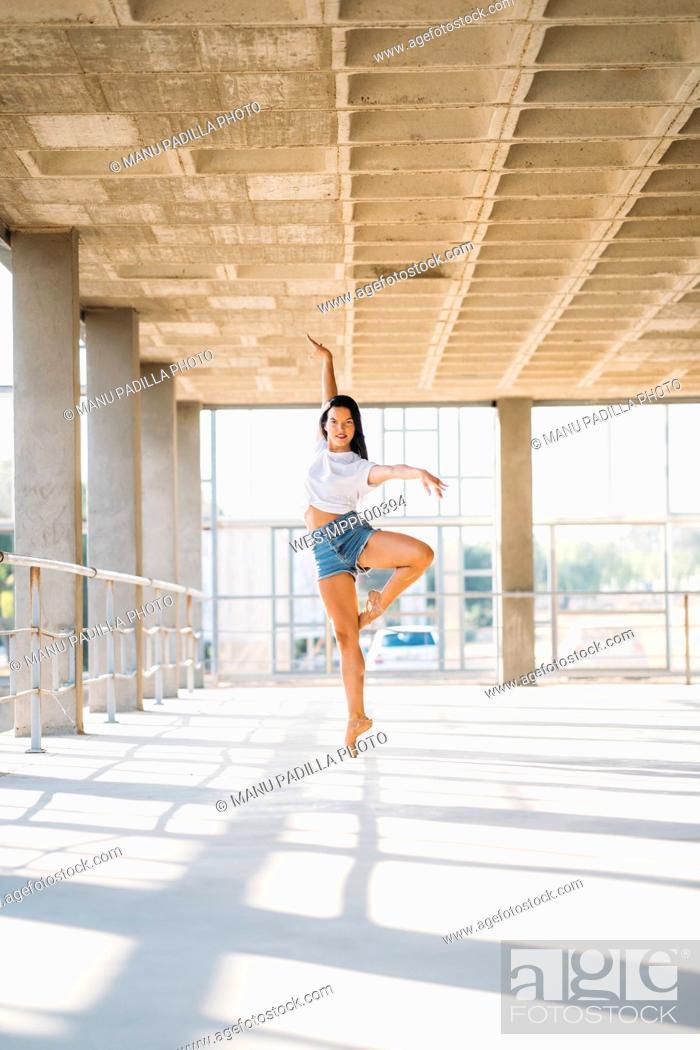 Stock Photo: Ballerina dancing in gym.