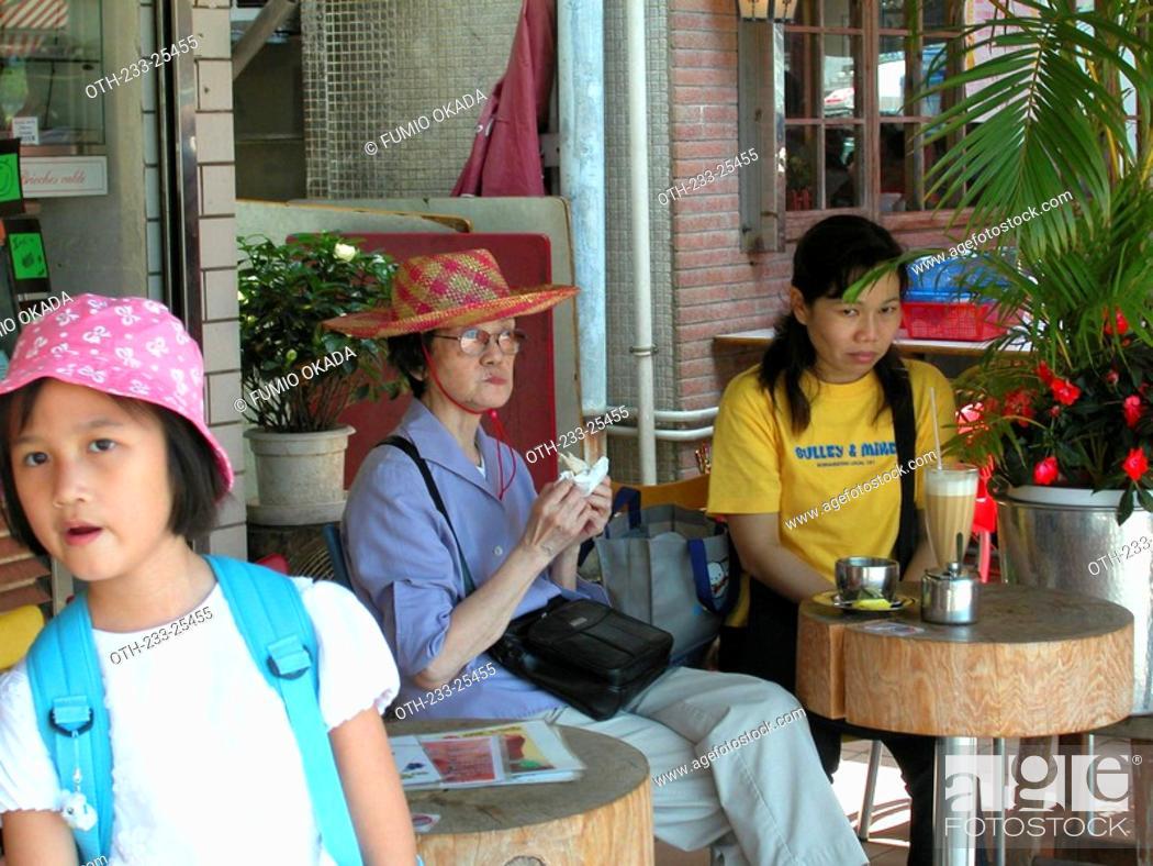 Stock Photo: Women enjoying a light meal at a café, Lamma Island, Hong Kong.