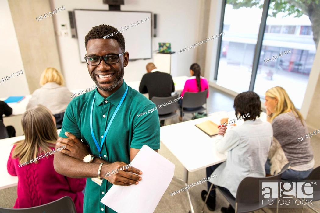 Stock Photo: Portrait confident male community college instructor in classroom.