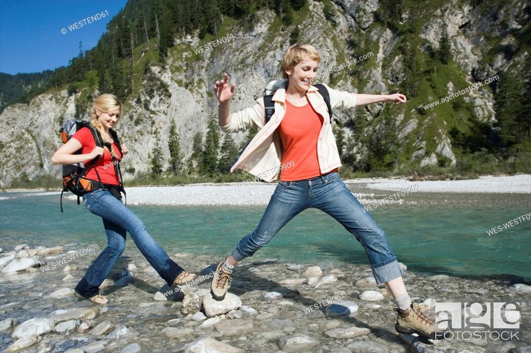 Stock Photo: Germany, Bavaria, Tölzer Land, Girlfriends hiking.