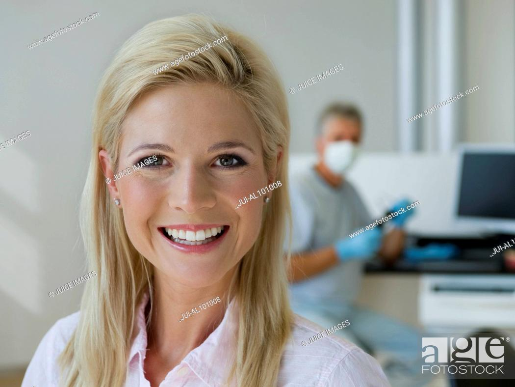 Stock Photo: Hygienist in dentist's office.