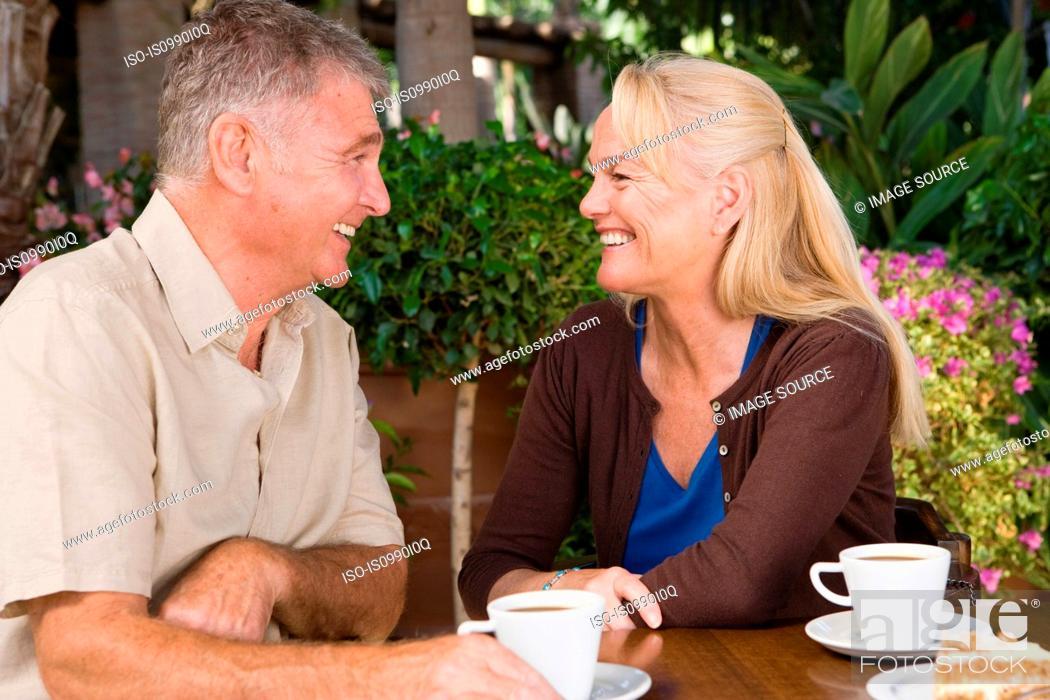 Stock Photo: Mature couple having coffee.
