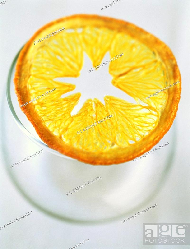 Stock Photo: Dried orange slice on top of glass.