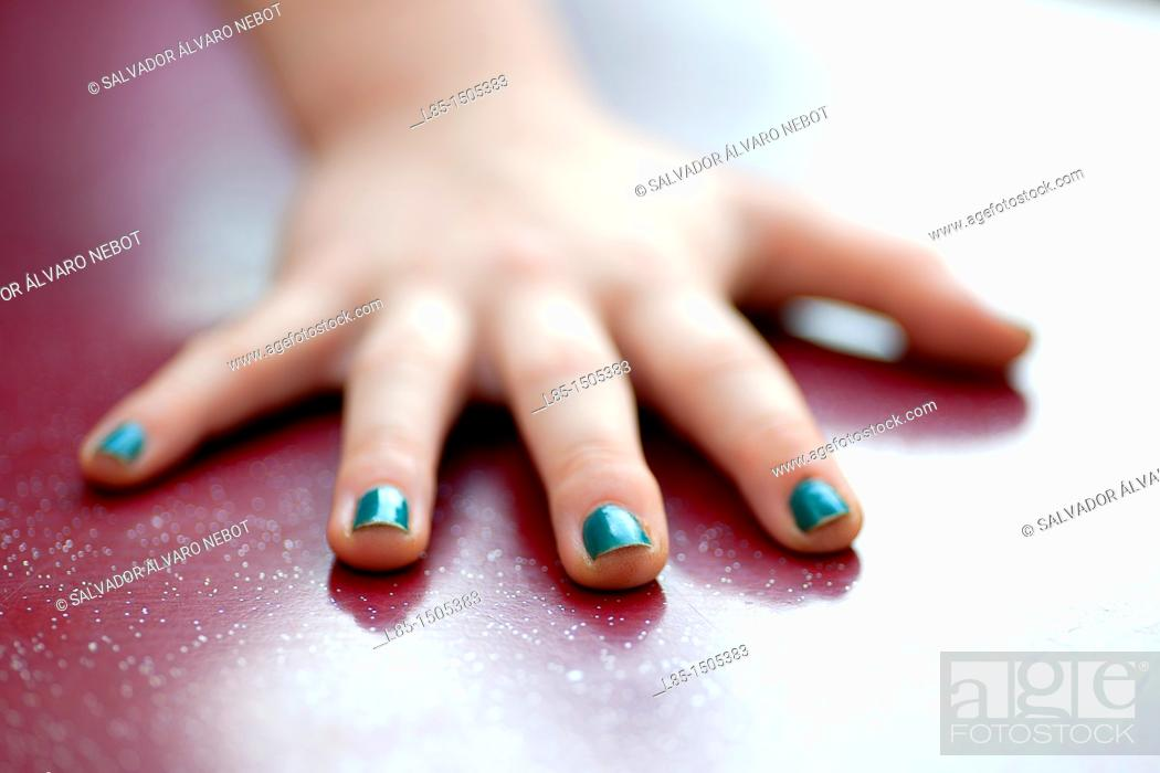 Stock Photo: Hand girl with painted nails.