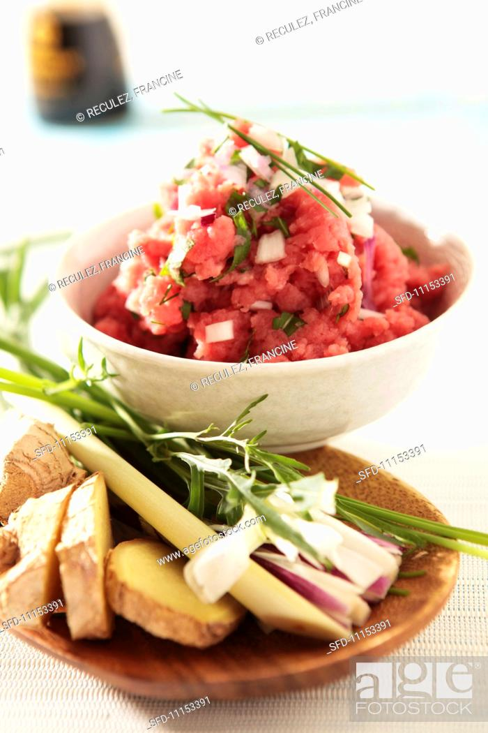 Stock Photo: Tartare of meat with chives and onions.