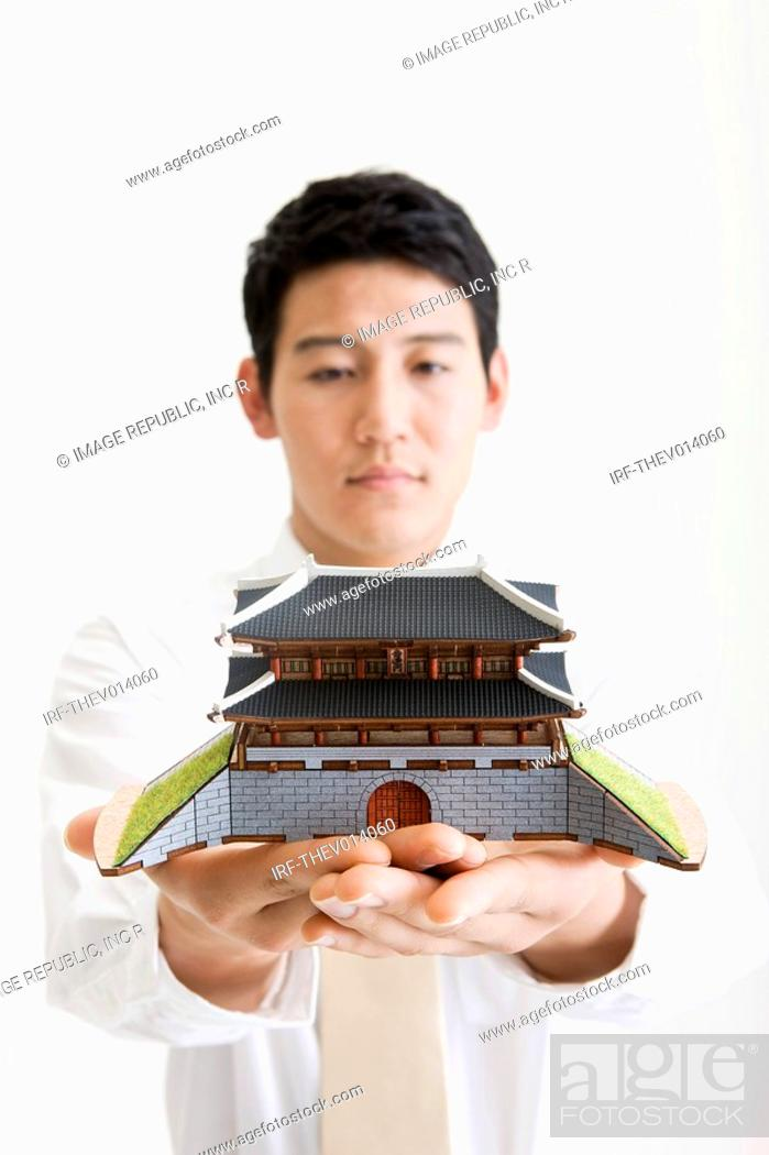 Stock Photo: businessman holding a Namdaemoon.