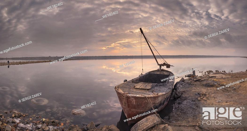Stock Photo: Old boat of the mud getters on the salt lake Kuyalnik in Odessa, Ukraine.