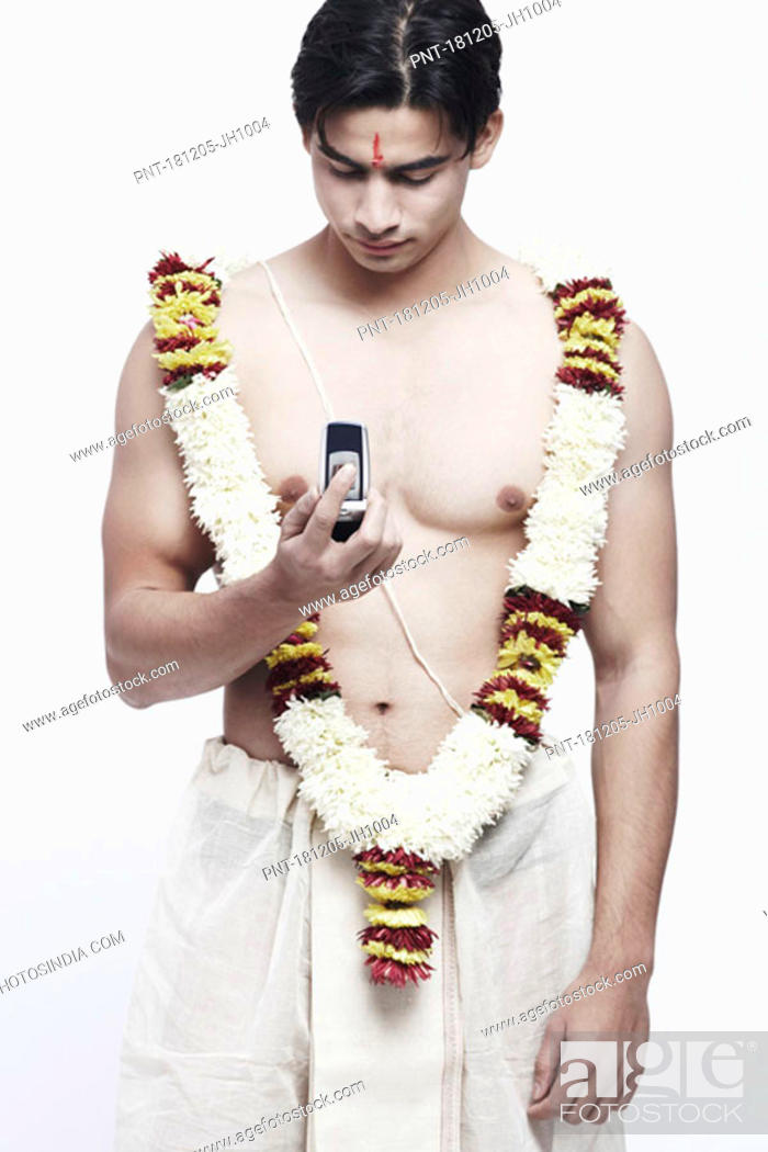 Stock Photo: Close-up of a young man holding a mobile phone.