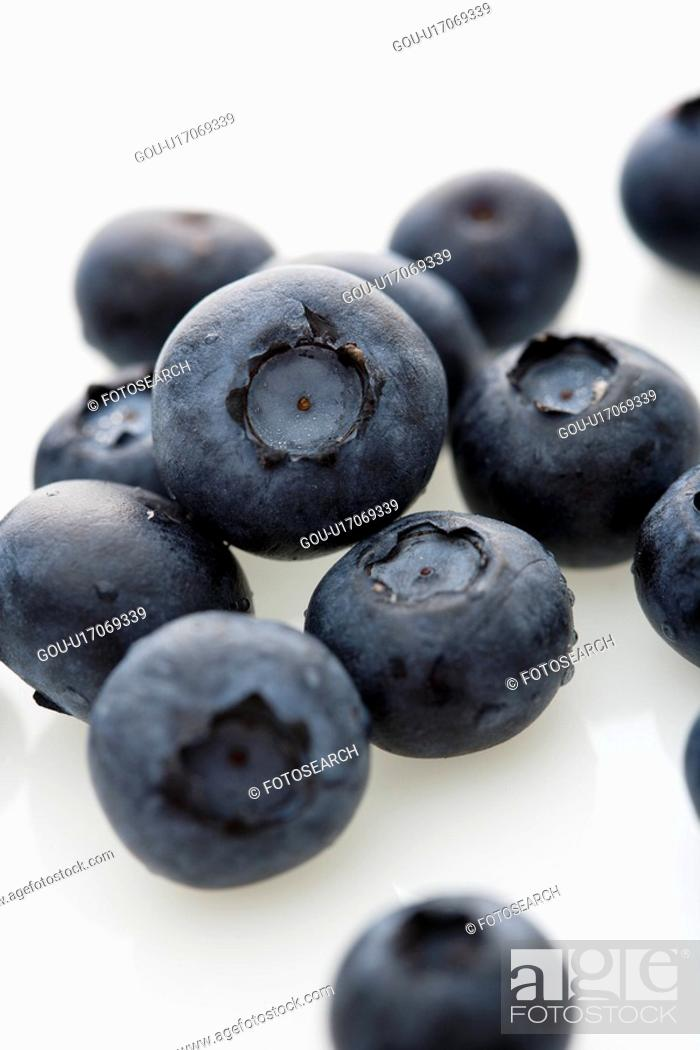 Stock Photo: Group of blueberries on white background.