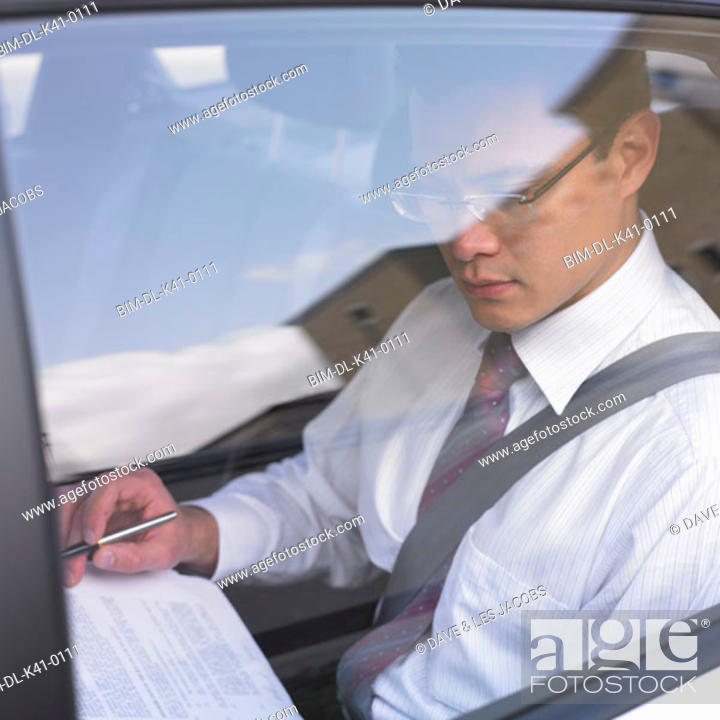Stock Photo: Businessman riding in a car.