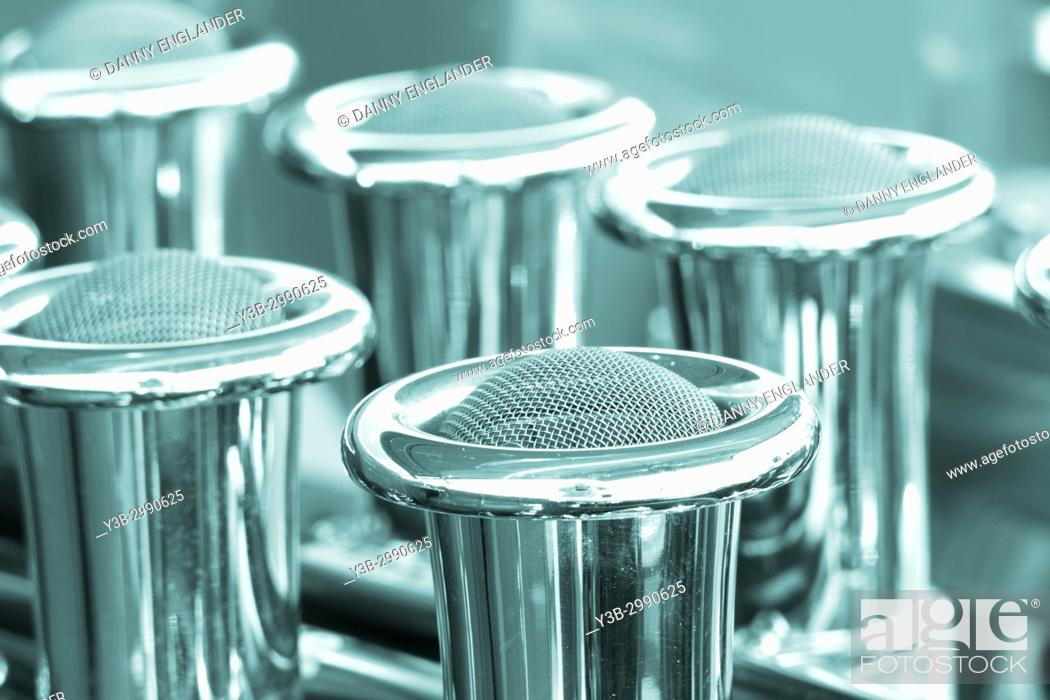 Stock Photo: Close-up macro view of engine cylinders from an antique automobile.