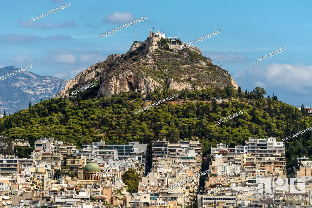 Stock Photo: Cityscape of Athens and Lycabettus Hill, also known as Lykabettos, Lycabettos or Lykavittos. It is a Cretaceous limestone hill in Athens, Greece.