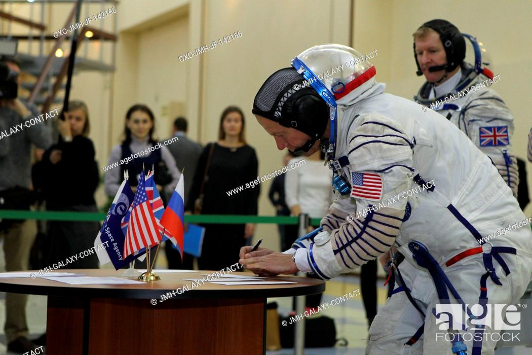 Stock Photo: At the Gagarin Cosmonaut Training Center in Star City, Russia, Expedition 46-47 crewmember Tim Kopra of NASA signs in for his qualification exam Nov.