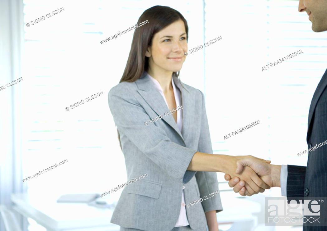 Stock Photo: Businesswoman shaking hands.