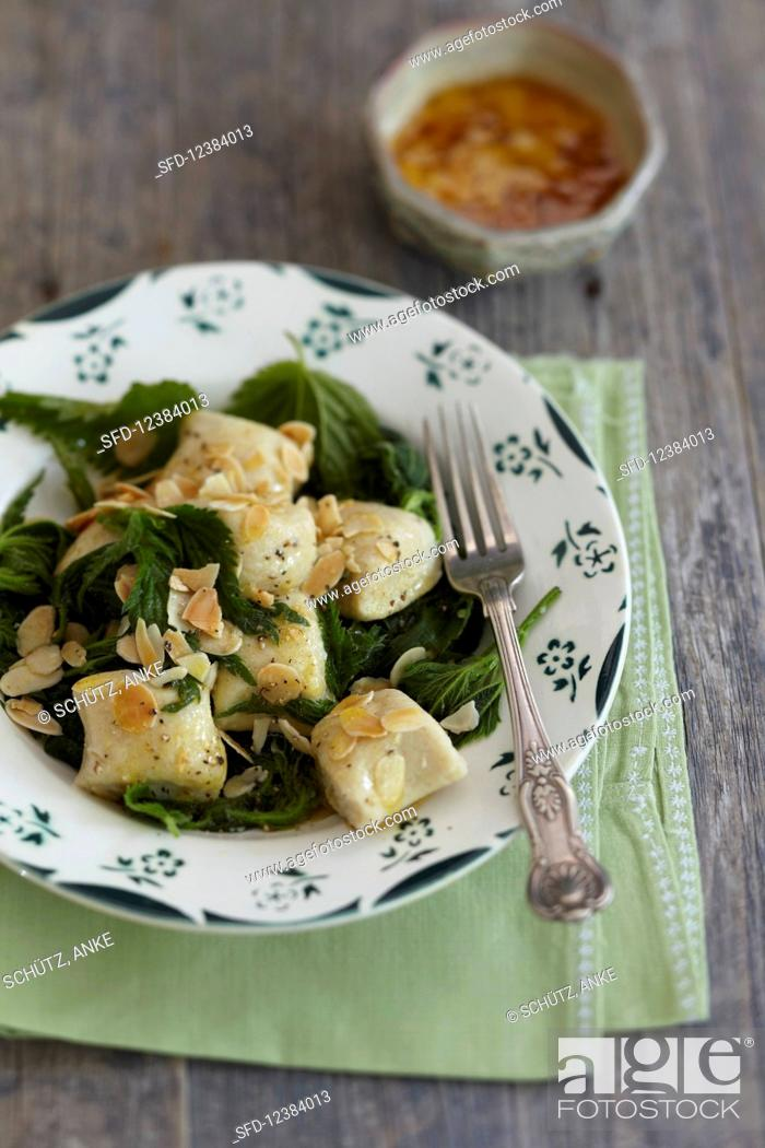 Stock Photo: Gnocchi with stinging nettle and flaked almonds.