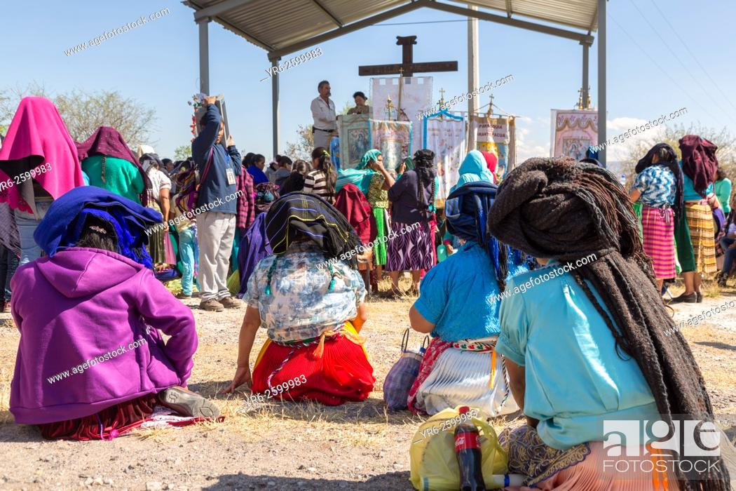 Stock Photo: Indigenous pilgrims listen to an outdoor mass on the pilgrimage route to the Sanctuary of Atotonilco an important Catholic shrine in Atotonilco, Mexico.
