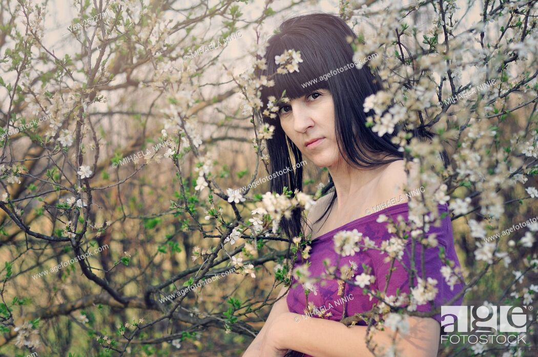 Stock Photo: Portrait of mid adult woman, spring.