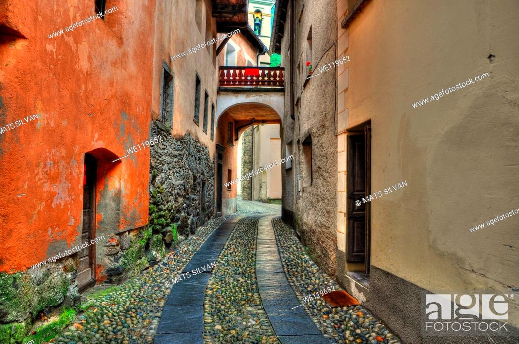 Stock Photo: Tight alley with old rustic houses in ticino switzerland.