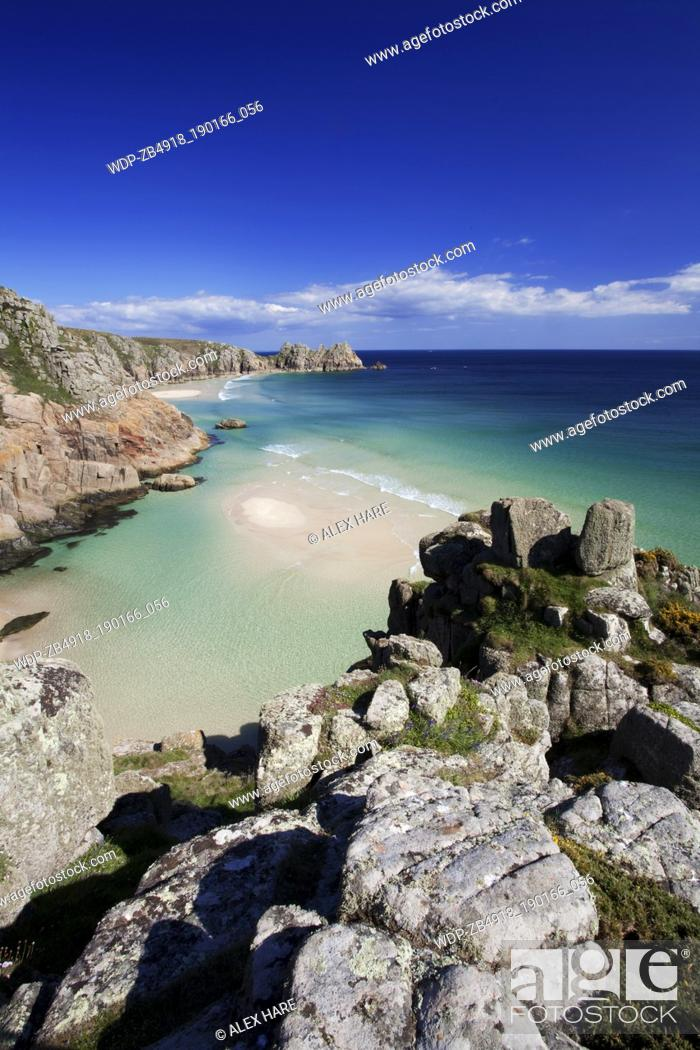 Stock Photo: A view of the sandy beach at Porthcurno with Logan rock in the distance.