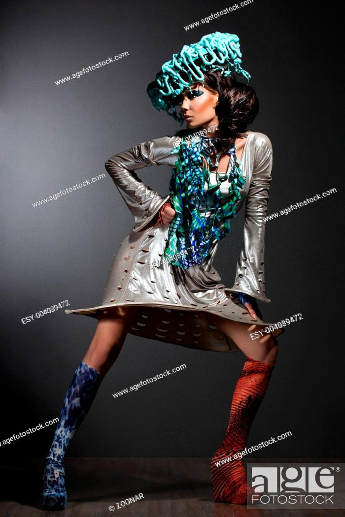 Stock Photo: fashionable woman with art visage and hat.