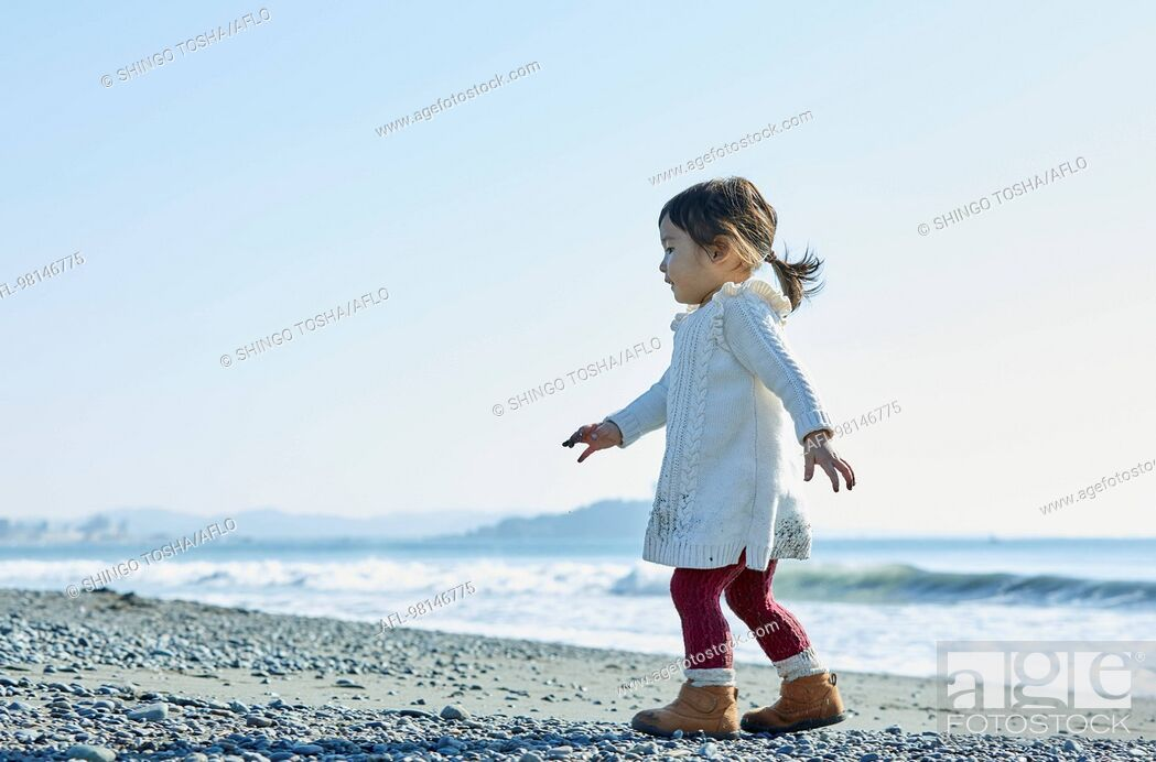 Stock Photo: Japanese kid at the beach.