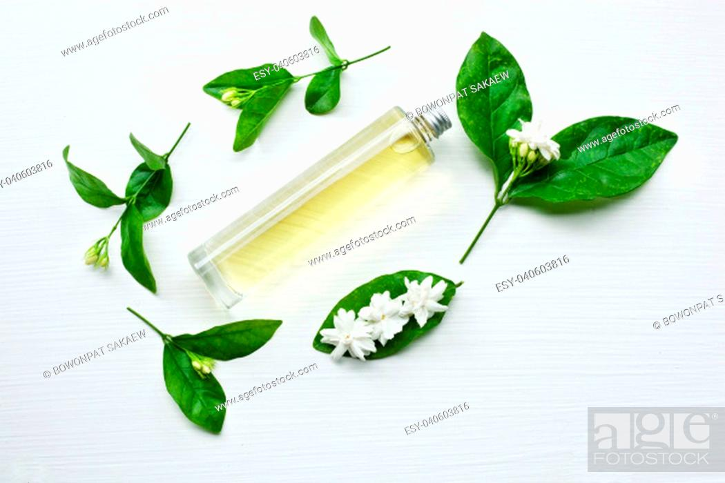 Stock Photo: Essential oil with jasmine flower on white background.