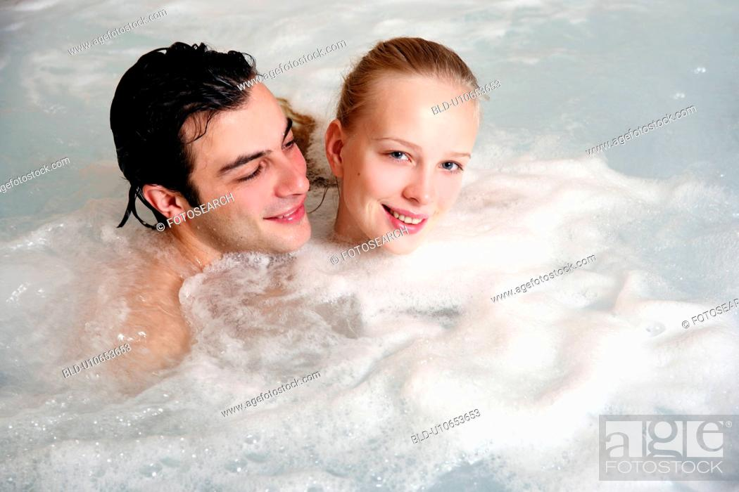 Stock Photo: One man with woman in jacuzzi at a spa.