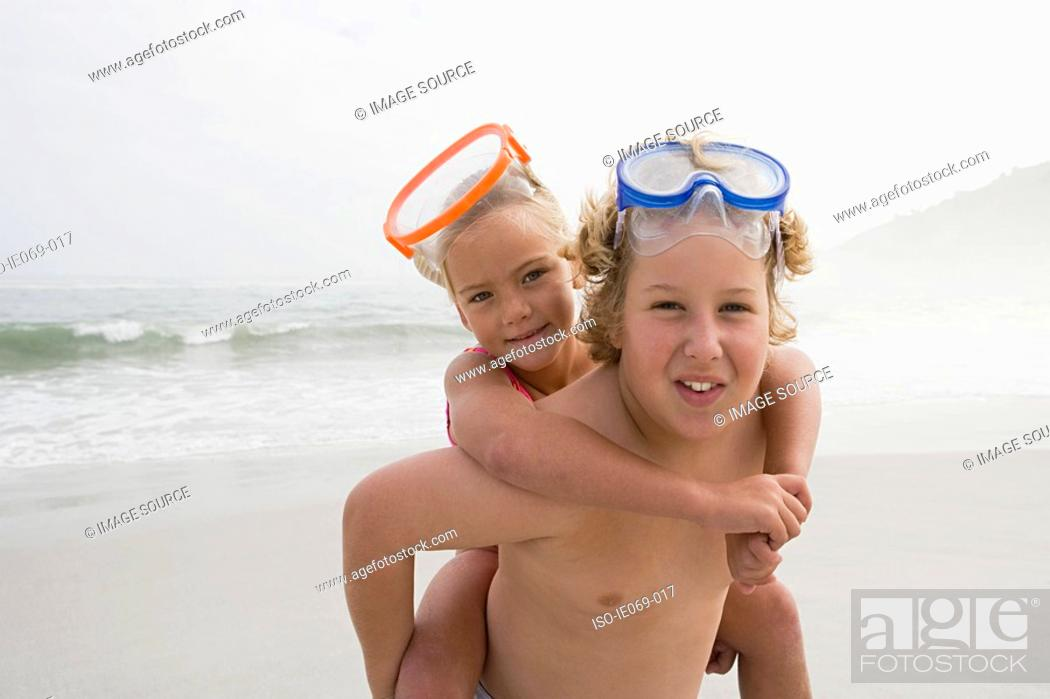 Stock Photo: Boy and girl by the sea.
